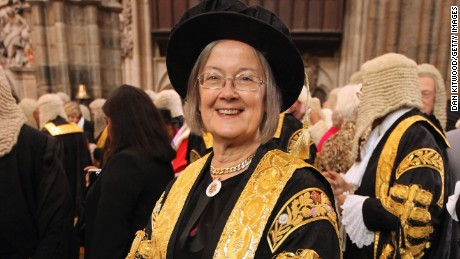 Baroness Hale of Richmond, One of the new 11 Justices of the Supreme Court, and the only woman, arrives in Westminster Abbey after being sworn in on October 1, 2009 in London, England. Lady Hale wears a hat despite other Justices of the Supreme court breaking tradition and choosing not to wear wigs. The Judges, who are to replace the former Law Lords, mark the start of the legal year with a traditional religious service, arriving from the Royal Courts of Justice for a service which is followed by a procession to The Houses of Parliament and then a reception held by the Lord Chancellor. The ceremony in Westminster Abbey has roots in the religious practice of the judges praying for guidance at the start of the legal year. The custom dates back to the Middle Ages when the High Court was held in Westminster Hall.