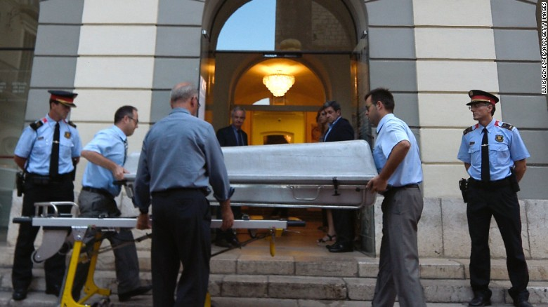 A casket is taken inside the Teatre-Museu Dali (Theatre-Museum Dali) with forensic examiners for the exhumation of Salvador Dali's remains in Figueras on July 20, 2017.