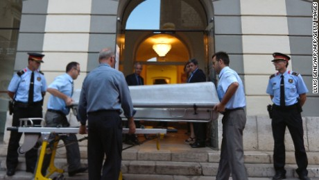 Undertakers take a casket inside for the exhumation of Salvador Dali's remains in Figueras on July 20.