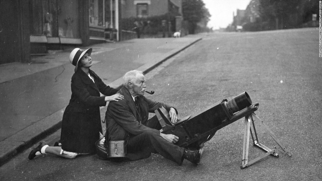 Amateur astronomers and spectators got up early to witness and photograph a total eclipse of the sun in London in 1936.