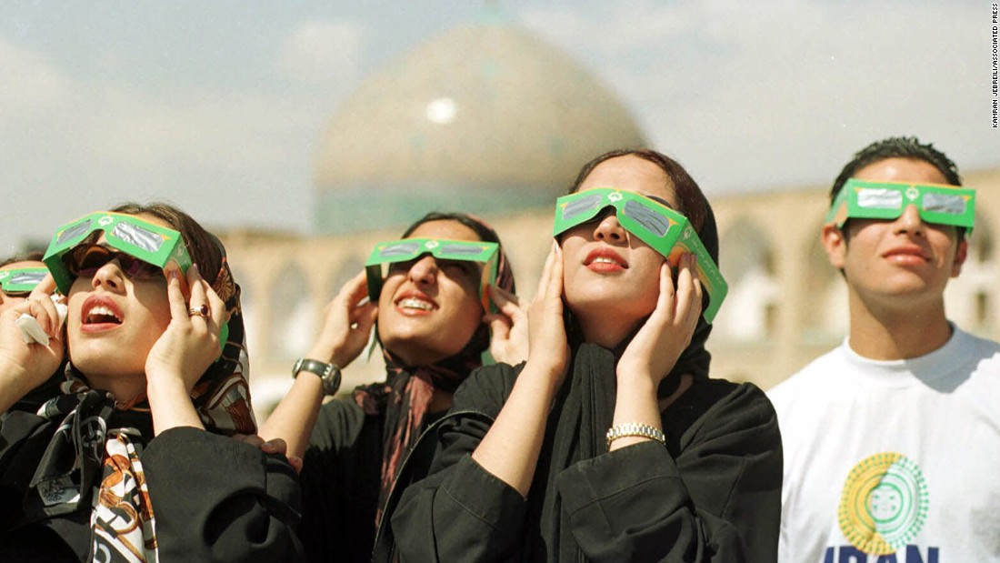 Iranian teenagers observed the solar eclipse in front of Sheikh Lotfollah Mosque in Naghsh-e Jahan Square, in Isfahan, Iran on  August 11, 1999.