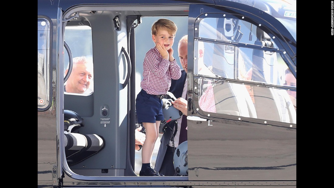 Prince George and Prince William view helicopter models H145 and H135 before departing from Hamburg on the last day of their official visit to Germany.