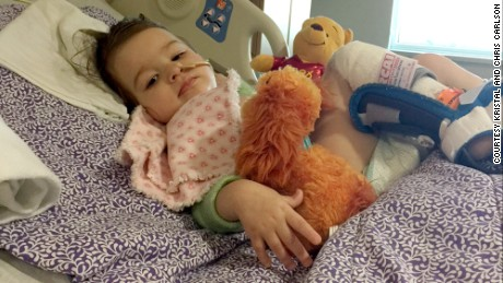 Eden Carlson in the hospital following hyperbaric oxygen therapy treatment.