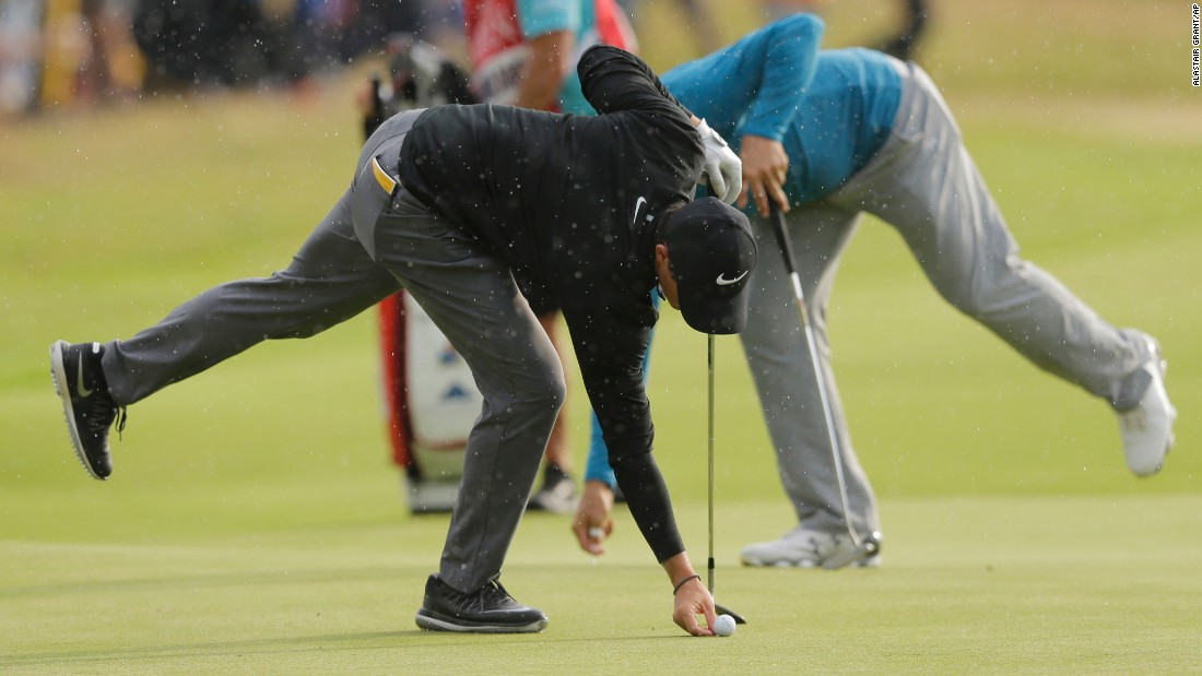 McIlroy, left, and Gary Woodland of the United States gave chase but couldn't make any inroads into the leaders.