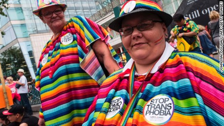 "Participants wear ""Stop transphobia"" stickers during Berlin's annual Christopher Street Day (CSD) gay pride parade on July 22, 2017. Gays and lesbians all around the World are celebrating the Christopher Street Day (CSD) gay and lesbian pride parade. / AFP PHOTO / John MACDOUGALL        (Photo credit should read JOHN MACDOUGALL/AFP/Getty Images)"