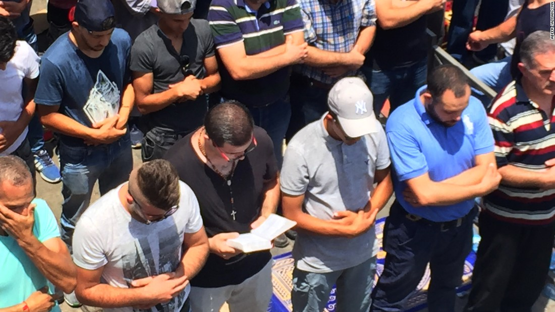 Christian man prays with Jerusalem Muslims as tensions flare