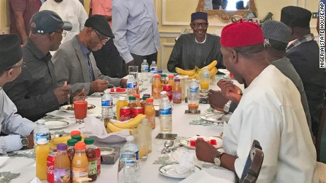 In this Sunday July. 23, 2017 photo released by the Nigeria State House, Nigeria's President Muhammadu Buhari, back centre, during a meeting with Nigeria ruling party's governors, in London Sunday July 23, 2017. Nigeria's government has released the photo of President Muhammadu Buhari more than two months after he left for London for medical treatment amid growing health concerns.