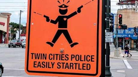 "This street sign, warning of ""easily startled"" Twin Cities police, was put up on a corner in St. Paul, Minnesota. Another was put up in Minneapolis."