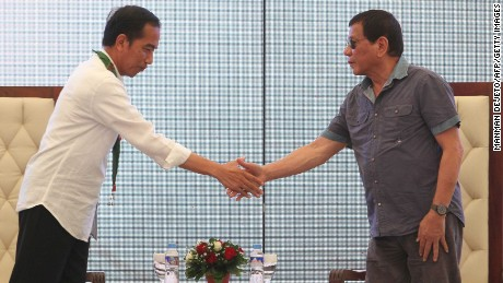 Indonesian President Joko Widodo (L) and President Rodrigo Duterte (R) shake hands in Mindanao, Philippines, on April 30.