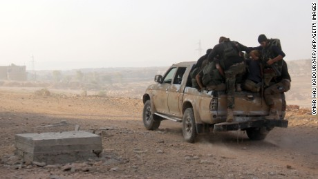 Fighters from the former Al-Nusra Front -- renamed Fateh al-Sham Front after breaking from Al-Qaeda -- advance on a road as they seized key positions south of Aleppo on August 6, 2016 in a major offensive to break the government siege of the city, the Syrian Observatory for Human Rights said.    Fateh al-Sham Front announced having captured two military academies and a third military position.   / AFP / Omar haj kadour        (Photo credit should read OMAR HAJ KADOUR/AFP/Getty Images)