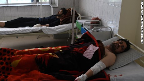 Afghan men rest in a hospital after being injured in a car bomb attack in Kabul on July 24, 2017. At least 24 people have been killed and 42 wounded after a car bomb struck a bus carrying government employees in western Kabul on July 24, an official told AFP, the latest attack to strike the Afghan capital.  / AFP PHOTO / SHAH MARAI        (Photo credit should read SHAH MARAI/AFP/Getty Images)