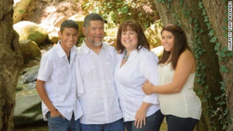 Tony Melendez with his wife and two children.