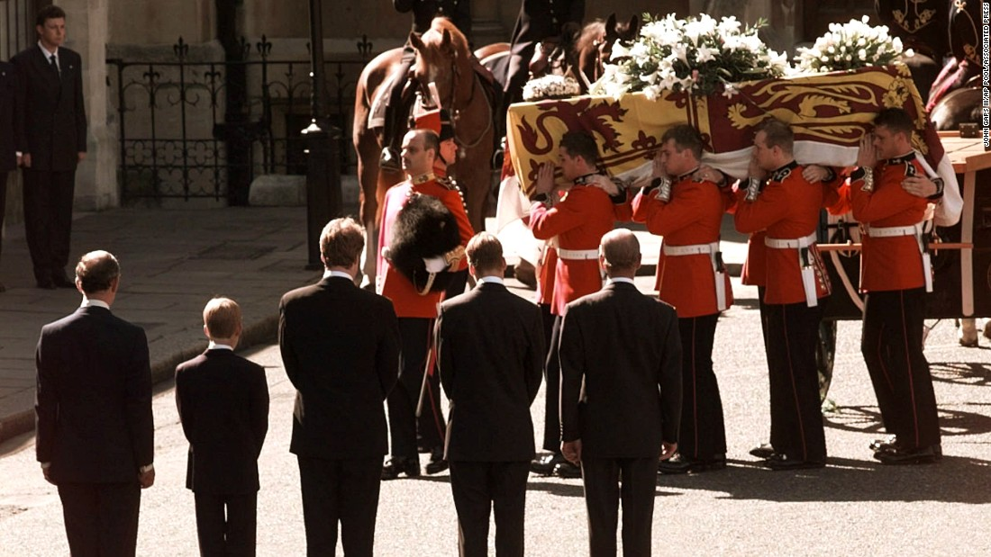 Diana's coffin is carried into London's Westminster Cathedral in September 1997. Watching at the bottom, from left, is Prince Charles, Prince Harry, Charles Spencer, Prince William and Prince Philip.
