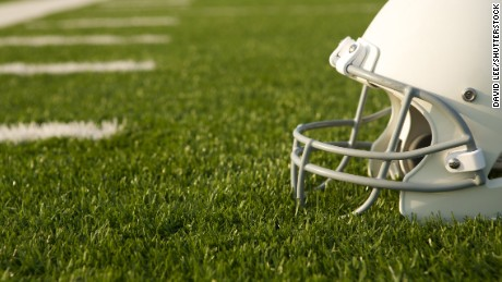American Football Helmet on the Field with room for copy; Shutterstock ID 152570240