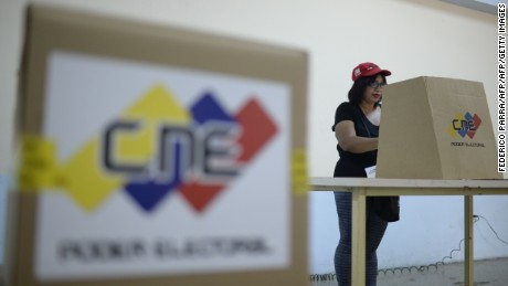 A supporter of Venezuelan President Nicolas Maduro takes part in Caracas on July 16, 2017 in a dry-run simulation to elect the members of a citizens' body to redraft the country's basic law, which is to be held on July 30, as the opposition holds a symbolic vote to reject Maduro's plans to rewrite the constitution. Authorities have refused to greenlight the vote that has been presented as an act of civil disobedience and supporters of Maduro are boycotting it. Protests against Maduro since April 1 have brought thousands to the streets demanding elections, but has also left 95 people dead, according to an official toll.  / AFP PHOTO / Federico PARRA        (Photo credit should read FEDERICO PARRA/AFP/Getty Images)