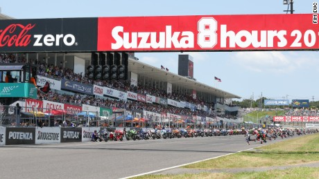 Riders rush towards thier motorbikes at the start of the 2016 Suzuka 8 Hours race.