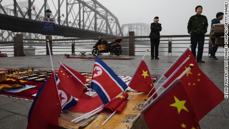 Chinese vendors sell North Korea and China flags on the boardwalk next to the Yalu river in the border city of Dandong, Liaoning province, northern China.