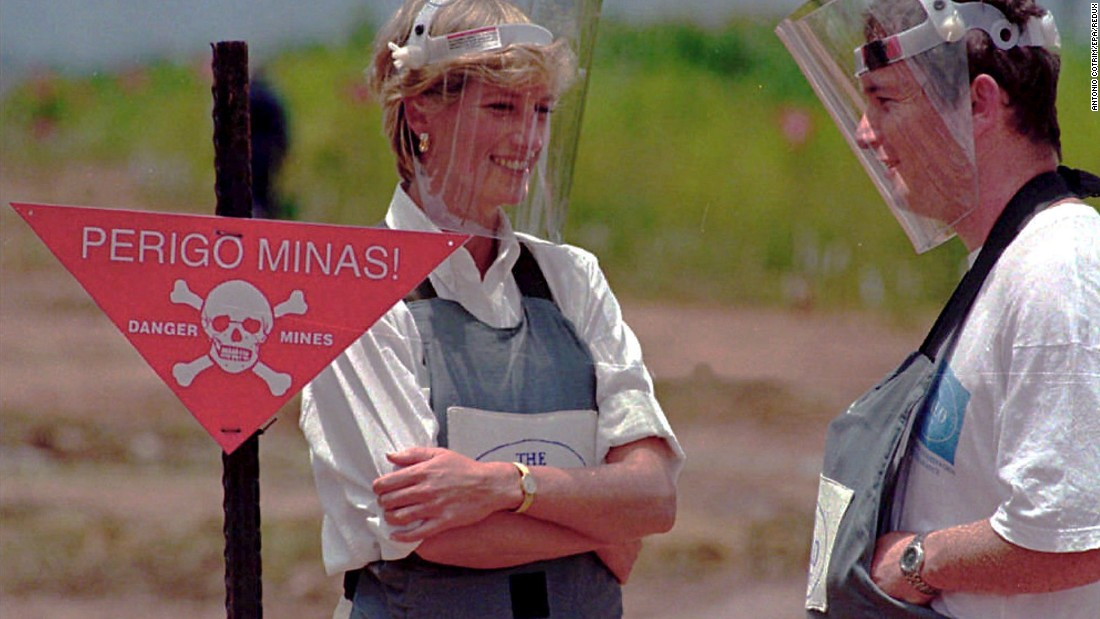 Diana wears protective gear as she visits minefields in Angola in January 1997.