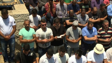 Jerusalem Christian man praying alongside Muslims