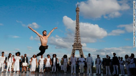 Syrian dancer Ahmad Joudeh performs on the Human Rights Square near the Eiffel Tower, in Paris.