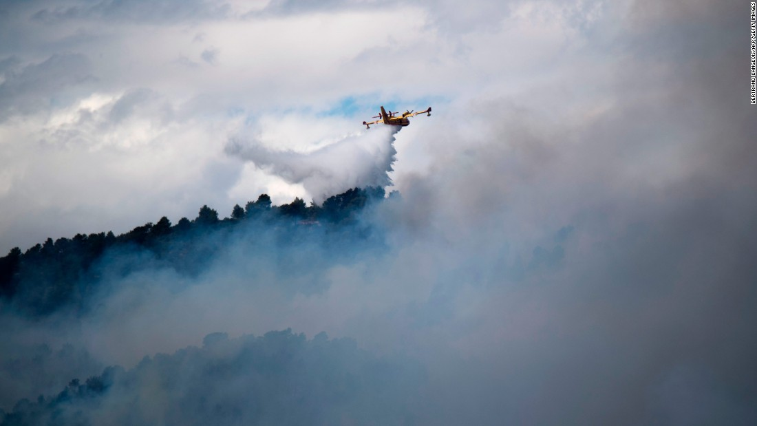 A firefighting plane drops water over a blaze in Mirabeau, France.