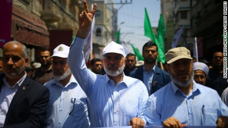 TOPSHOT - Hamas leader Ismail Haniya (C) and spokesman Fawzi Barhoum (L) attend a protests in Gaza City on July 22, 2017, against new Israeli security measures implemented at the holy site, which include metal detectors and cameras, following an attack that killed two Israeli policemen the previous week. Palestinian protesters clashed with Israeli forces outside Jerusalem's Old City as tensions mounted over new security measures at a highly sensitive holy site and prompted police to restrict access for Muslim prayers. / AFP PHOTO / MOHAMMED ABED        (Photo credit should read MOHAMMED ABED/AFP/Getty Images)
