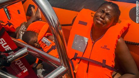 A woman cries after being rescued in the Mediterranean Sea about 15 miles north of Sabratha, Libya, on Tuesday, July 25, 2017.