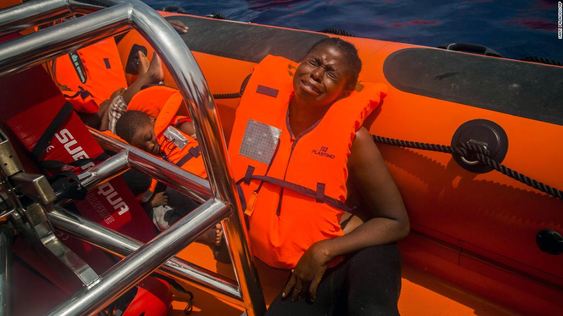 "A woman cries <a href=""http://www.cnn.com/2017/07/26/europe/migrant-crisis-mediterranean/index.html"" target=""_blank"">after being rescued</a> in the Mediterranean Sea about 15 miles north of Sabratha, Libya, on July 25, 2017. More than 100,000 refugees and migrants have risked their lives crossing the Mediterranean in 2017, according to the UN refugee agency. More than <a href=""http://www.unhcr.org/en-us/europe-emergency.html"" target=""_blank"">2,300 of them </a>are feared to have drowned."