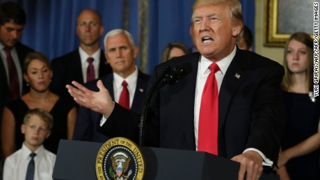 "US President Donald Trump delivers a statement on healthcare in front of alleged ""victims of Obamacare"" at the White House in Washington on July 24, 2017. / AFP PHOTO / YURI GRIPAS        (Photo credit should read YURI GRIPAS/AFP/Getty Images)"