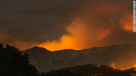 The Whittier Fire burns through the night on July 9, 2017 near Santa Barbara, California. The Whittier Fire and the Alamo Fire together have blackened more than 30,000 acres of chaparral-covered hills in Ventura County. Statewide, about 5,000 firefighters are fighting 14 large wildfires.