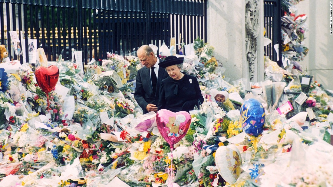 On the eve of Diana's funeral, the Queen and Prince Philip look at floral tributes left outside Buckingham Palace. More than 1 million bouquets of flowers were left at Kensington Palace, Buckingham Palace and St. James's Palace in the wake of Diana's death.