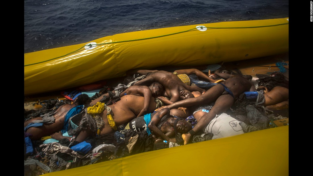 "Bodies of dead migrants are piled up inside a rubber boat in the Mediterranean Sea, about 15 miles north of Sabratha, Libya, on Tuesday, July 25. <a href=""http://www.cnn.com/2017/07/26/europe/migrant-crisis-mediterranean/index.html"" target=""_blank"">Rescuers saved 167 migrants from the boat</a> and said it was one of the worst conditions of overcrowding they had ever seen. <a href=""http://www.cnn.com/2015/09/03/world/gallery/europes-refugee-crisis/index.html"" target=""_blank"">Europe's migration crisis in 25 photos</a>"