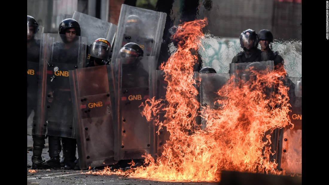 "A Molotov cocktail, thrown by anti-government protesters, explodes near members of the Venezuelan National Guard during clashes in Caracas on Wednesday, July 26. <a href=""http://www.cnn.com/2017/07/26/americas/venezuela-politics-explained/index.html"" target=""_blank"">Venezuela's political crisis explained</a>"