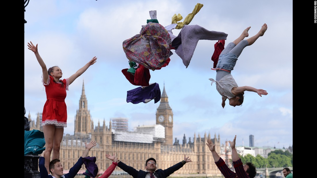 A circus stunt takes place in London near the Houses of Parliament on Tuesday, July 25. It was promoting Circus250, a nationwide festival celebrating 250 years of the modern-day circus.