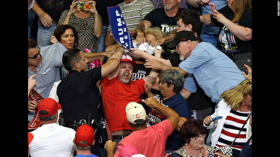 "A protester is escorted out of <a href=""http://www.cnn.com/2017/07/25/politics/trump-youngstown-ohio-campaign-rally/index.html"" target=""_blank"">a rally in Youngstown, Ohio, </a>as US President Donald Trump speaks on Tuesday, July 25."