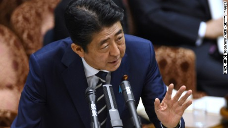 Japan's Prime Minister Shinzo Abe answers questions during a budget committee meeting in the Upper House at parliament in Tokyo on July 25, 2017, as he and other relevant ministers were expected to face more questioning over issues over a suspected scandal. For months Abe has been dogged by scandals, most recently claims he showed favouritism to a friend in a business deal, an accusation he denies. / AFP PHOTO / Kazuhiro NOGI        (Photo credit should read KAZUHIRO NOGI/AFP/Getty Images)