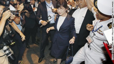 Defense Minister Tomomi Inada is surrounded by reporters as she leaves the Defense Ministry in Tokyo on July 27, 2017, following reports that she will step down over allegations of a coverup involving logs on the daily activities of Japanese ground troops serving as U.N. peacekeepers in South Sudan. (Kyodo) ==Kyodo (Photo by Kyodo News via Getty Images)