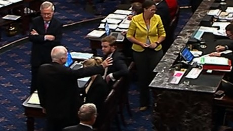 Cryptic calls, lip-reading and a thumbs-down: Behind McCain's dramatic vote