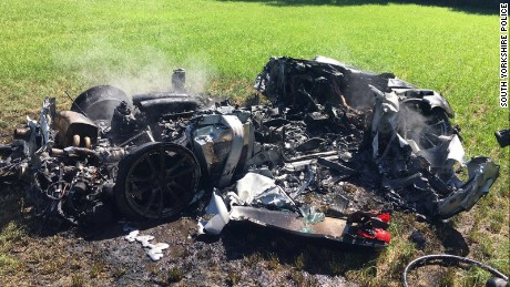 A driver had a miracle escape from a burning Ferrari in the UK.