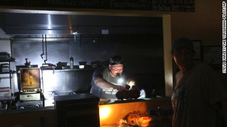 Aaron Howe cooks in the dark kitchen at the Island Convenience Store in Rodanthe.