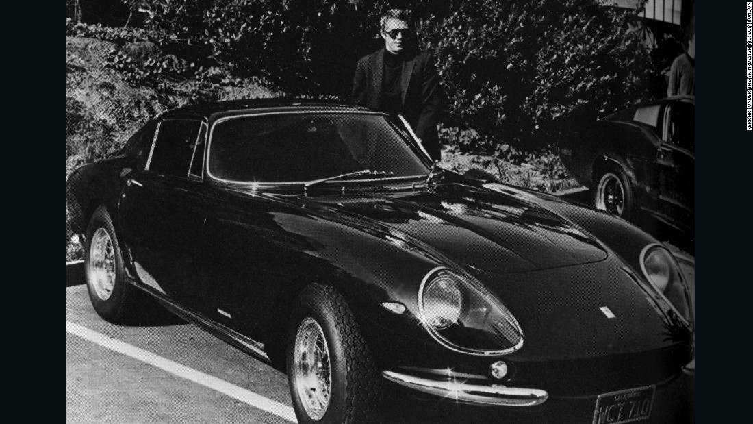 Thanks to a host of celebrity owners, the Ferrari brand was also rapidly building a reputation for elegance and style. Here, Steve McQueen stands proudly beside his Ferrari 275 GTB 4 by Scaglietti.