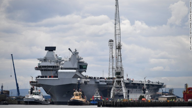 The new UK Royal Navy aircraft carrier HMS Queen Elizabeth departs Rosyth dockyard in Scotland to be tested in the North Sea on June 26, 2017.
