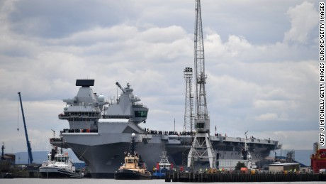 ROSYTH, SCOTLAND - JUNE 26:  The new Royal Navy aircraft carrier HMS Queen Elizabeth departs Rosyth dockyard to be tested in the North Sea on June 26, 2017 in Rosyth, Scotland. HMS Queen Elizabeth is the largest and most powerful surface warship ever built for the Royal Navy.  (Photo by Jeff J Mitchell/Getty Images)