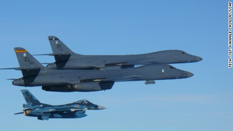 Two U.S. Air Force B-1B Lancers join a Japan Air Self-Defense Force F-2 fighter jet in a show of force after North Korea's latest missile test.