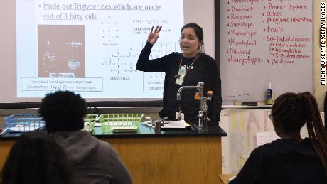 Science teacher Virginia Escobar-Cheng works with her students in a science class in a high school in Homestead, Florida, on March 10, 2017.