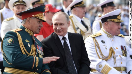 Russian Defense Minister Sergei Shoigu, President Vladimir Putin, and the commander-in-chief of the Russian Navy Adm. Vladimir Korolev review a naval parade in St. Petersburg.