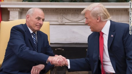President Donald Trump shakes hands with newly sworn-in White House Chief of Staff John Kelly at the White House in Washington, DC, on July 31, 2017.