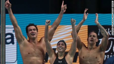 (Left to right) Nathan Adrian,Mallory Comerford and Caeleb Dressel celebrate after winning the mixed 4x100m freestyle at the World Aquatics Championships