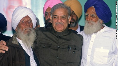 Punjab Chief Minister Muhammad Shahbaz Sharif poses with his father's friends in 2013.