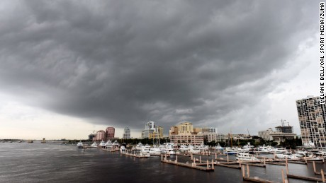 Rain moves in Monday on West Palm Beach after Emily made landfall and moved across Florida.